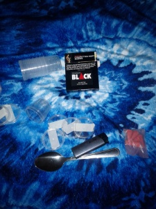 My kit: Incense, lighter, spoon, containers with labels, and cigarettes, all stored in a zipper sandwich bag